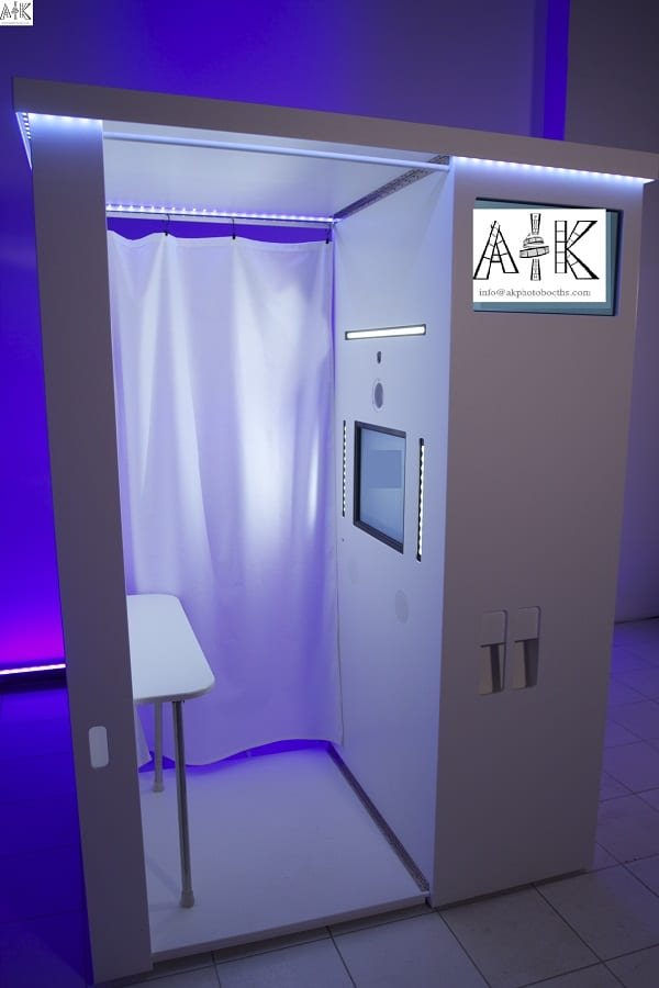 Traditional all white photo booth with touch screen and social medial in Dallas Texas