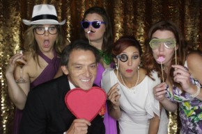open photo booth at edison's dallas wedding reception with gold backdrop